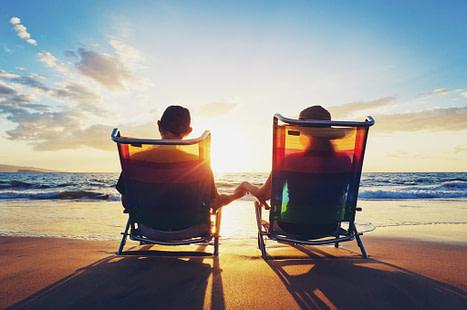 senior couple watching the sunset